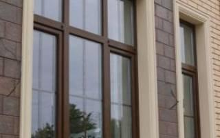Обрамление окон кирпичом на фасаде дома